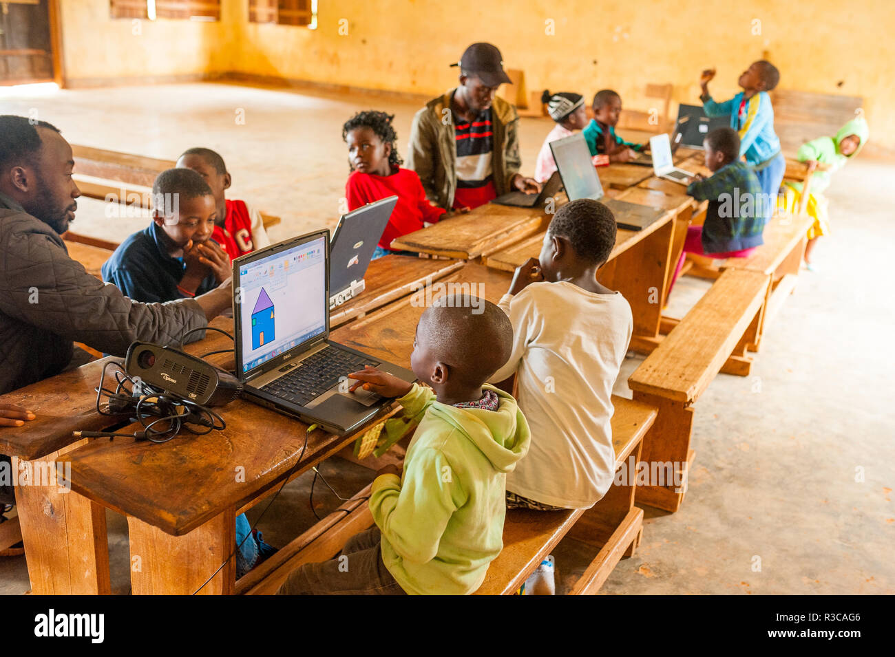 Bafoussam, Cameroon - 06 august 2018: young african teacher involve school children in learning technology with computer Stock Photo