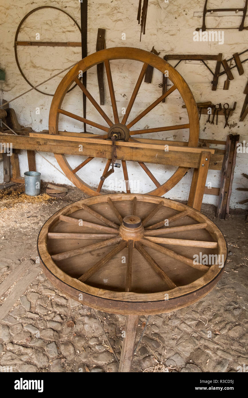 Cartwheels in a wheelwrights shop at Acton Scott Historic Working Farm, Shropshire, England, UK - Stock Image