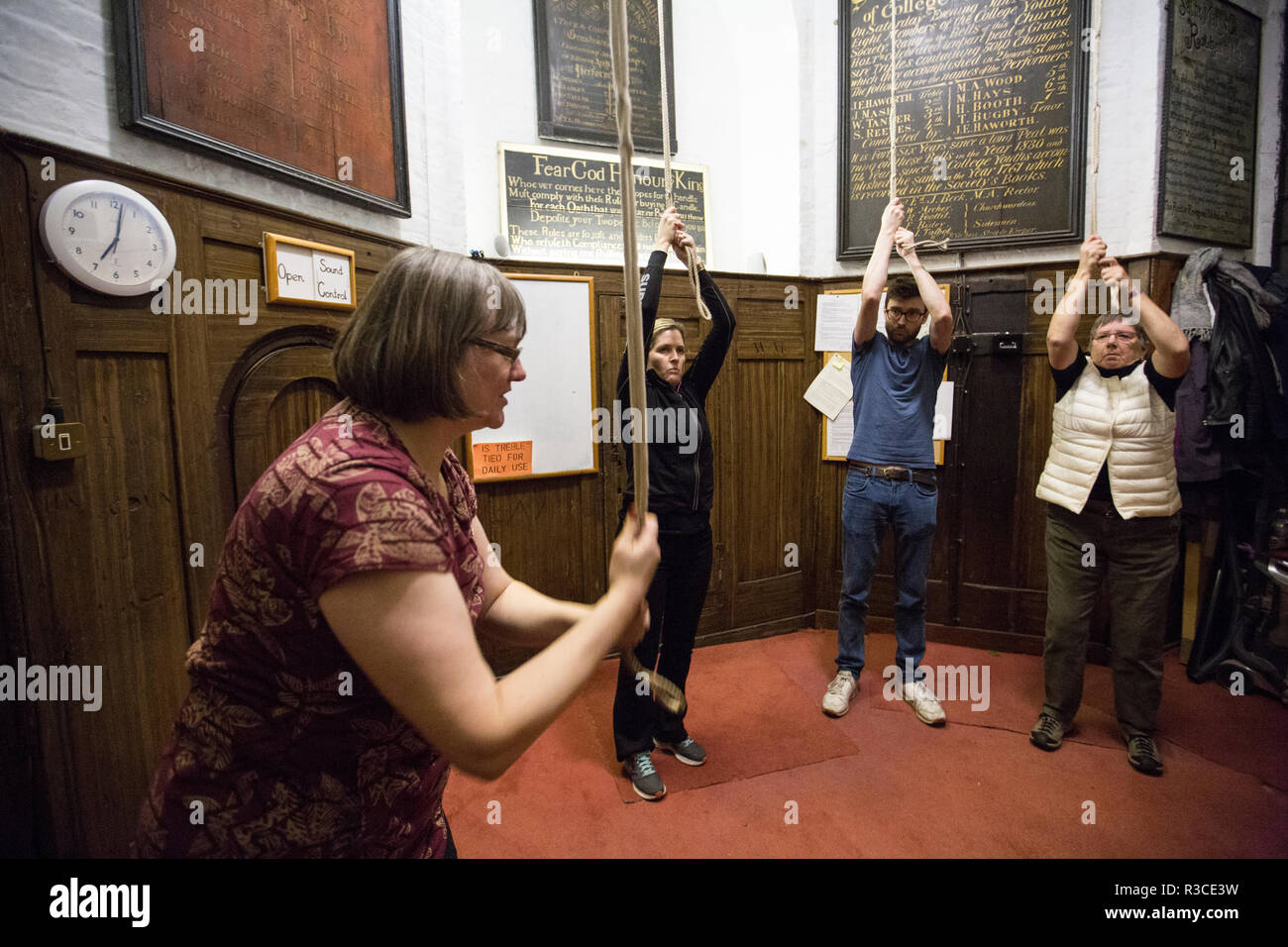 Church bell-ringers ahead of Remembrance Day practice their bell-ringing at St Mary's Church, Rotherhithe, Southeast London, United Kingdom Stock Photo