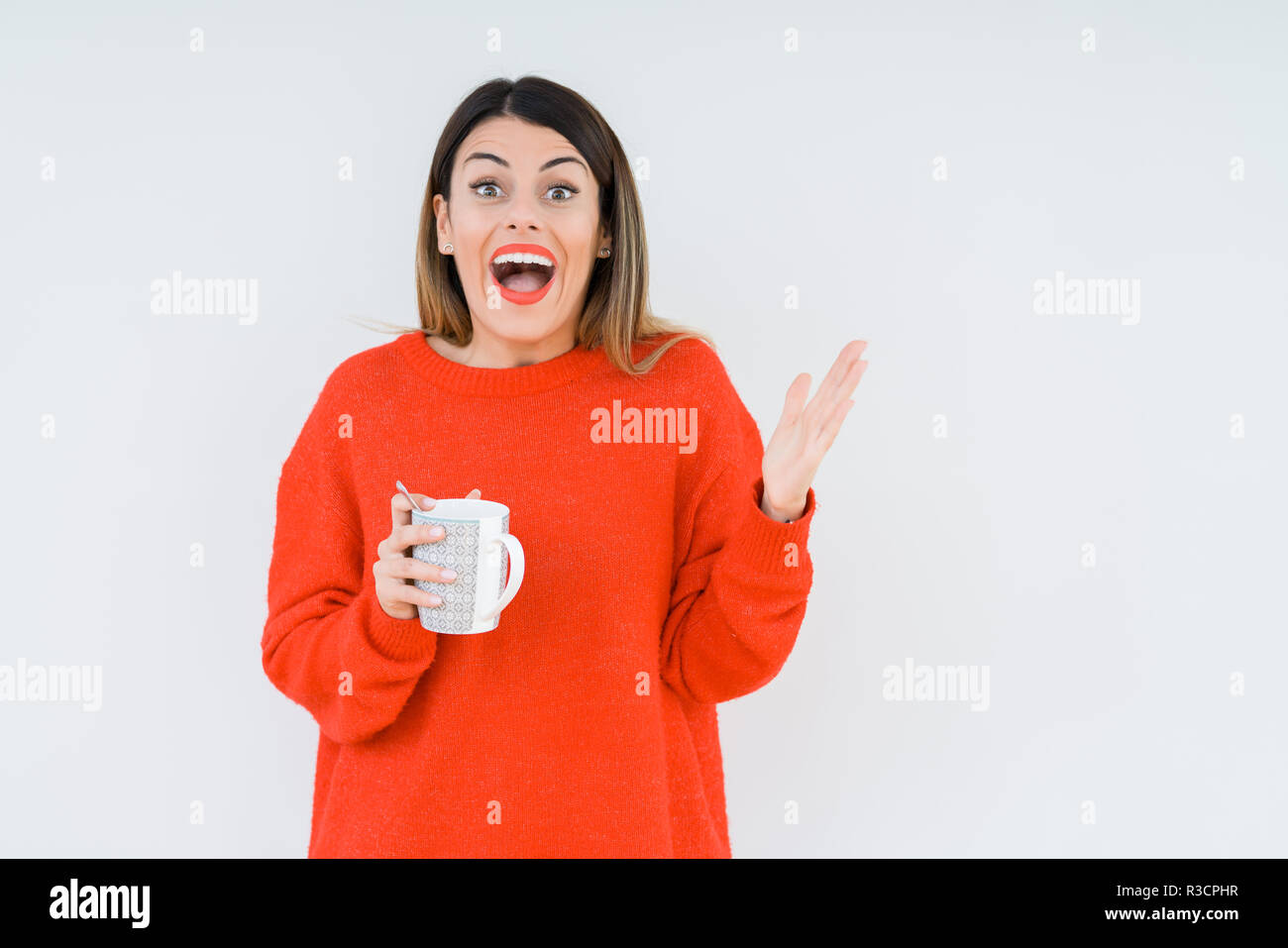 01d86622449 Young woman drinking cup of coffee over isolated background very happy and  excited, winner expression celebrating victory screaming with big smile and