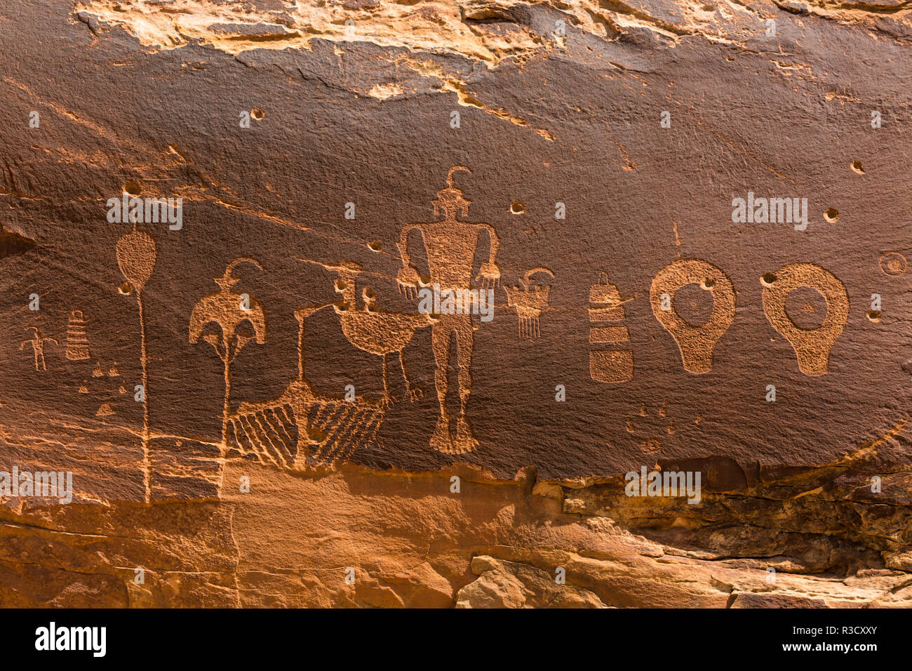 USA, Utah, Bears Ears National Monument. Wolfman Panel of petroglyphs in Butler Wash. - Stock Image