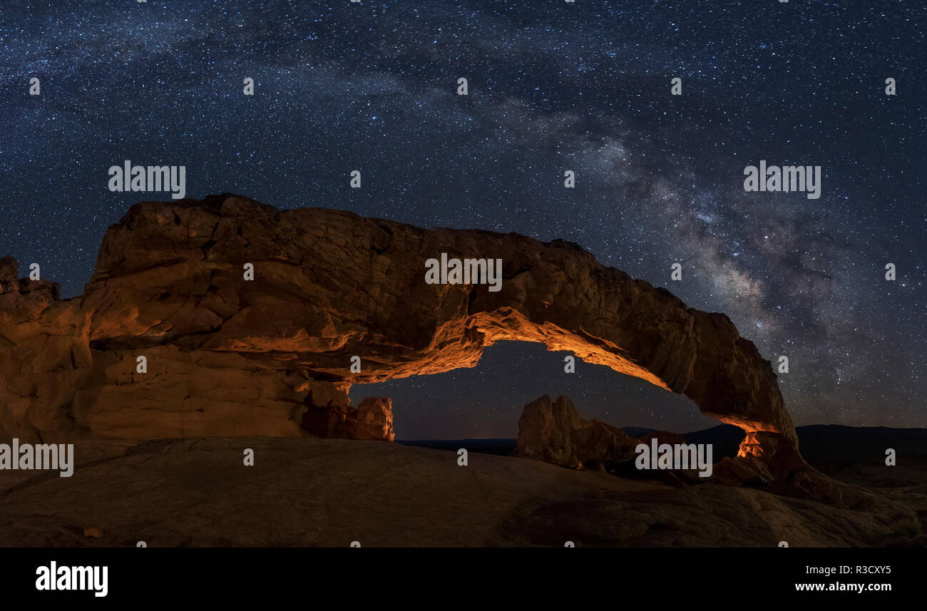 USA, Utah, Grand Staircase-Escalante National Monument. Milky Way and Sunset Arch. - Stock Image