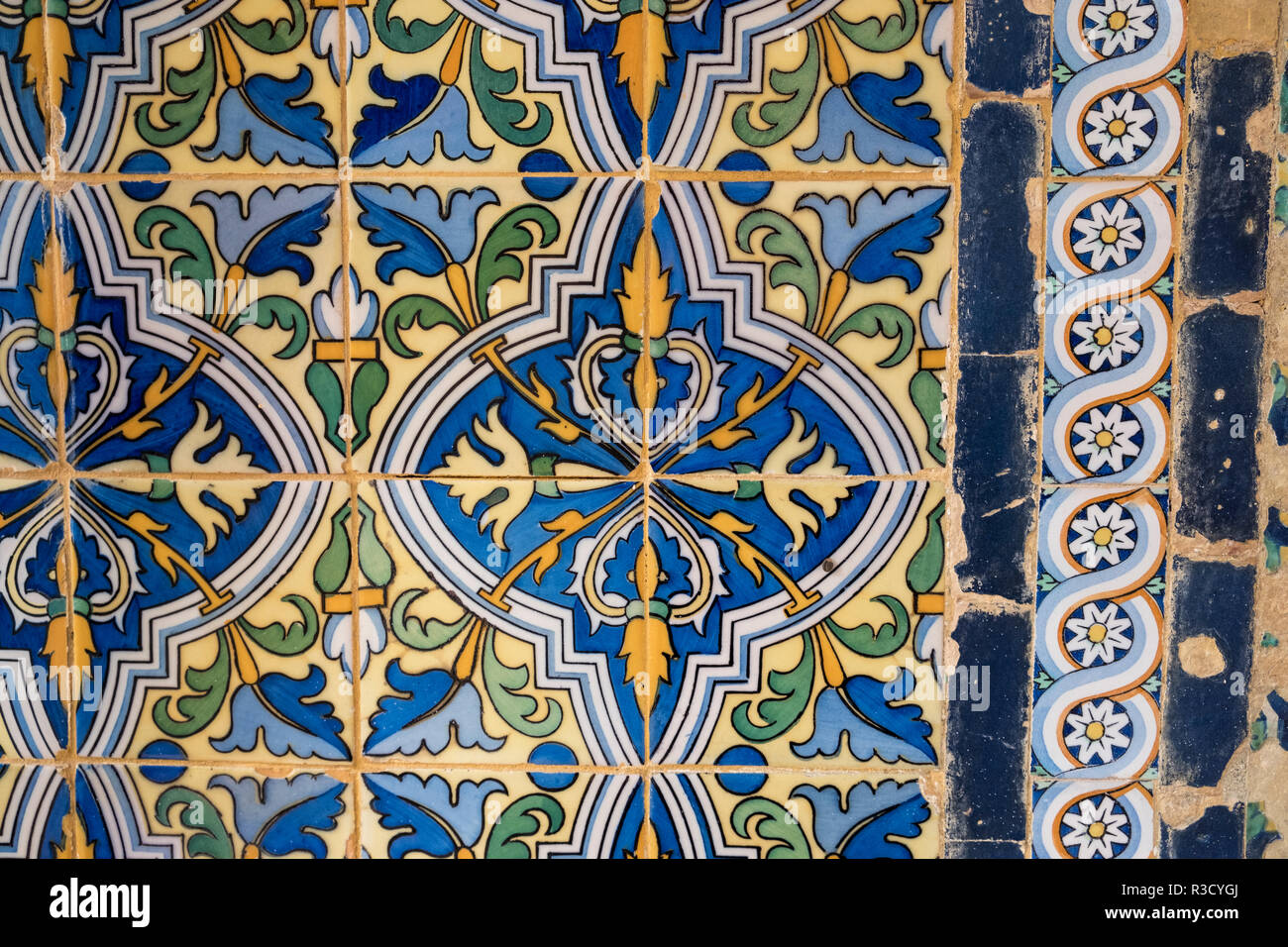 Section of ornate decorative wall tiles in the gardens of Real Alcazar, Seville, Andalucia, Spain - Stock Image