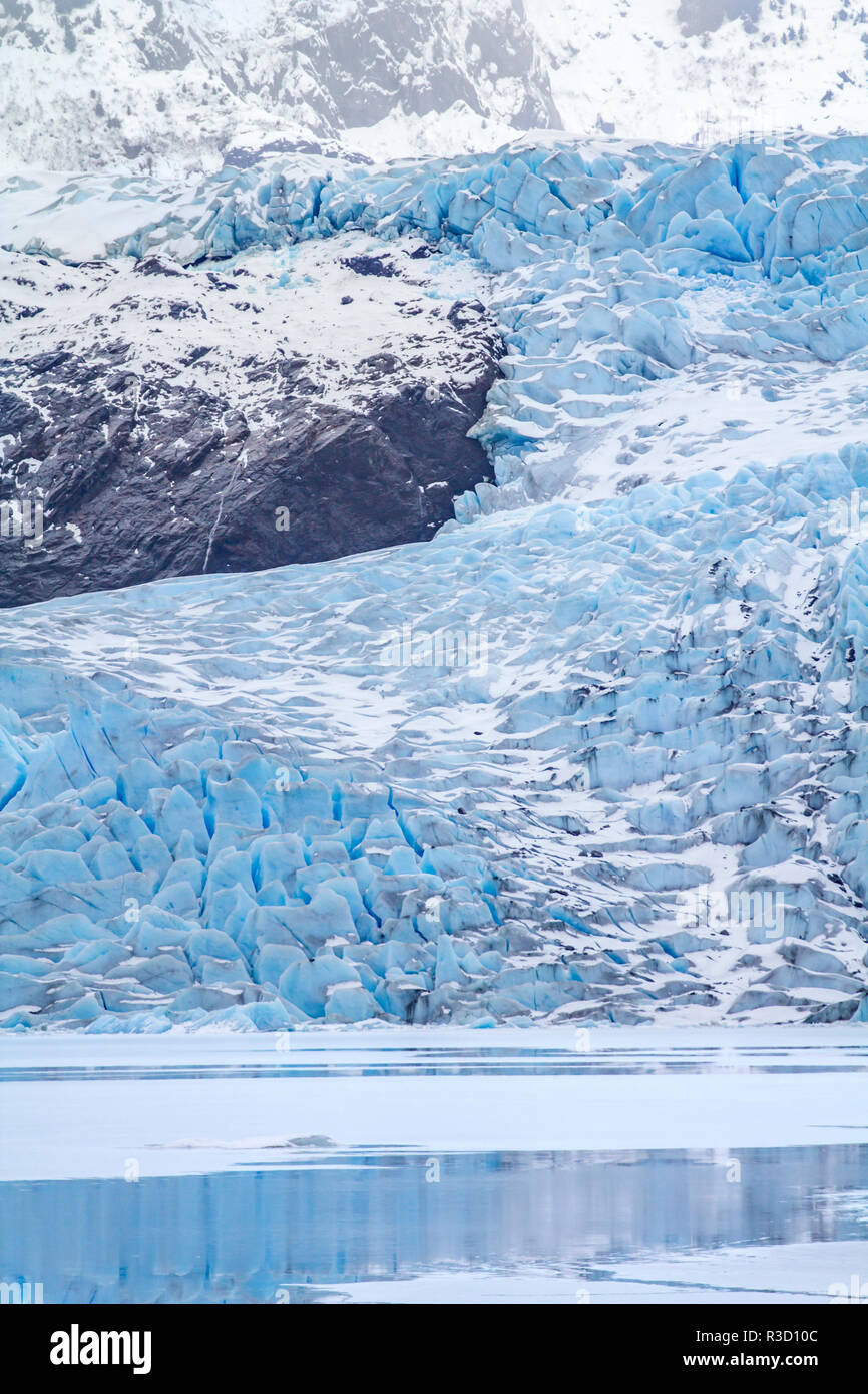 USA, Alaska. Mendenhall Glacier curves around a rocky promontory as it cascades to Mendenhall Lake. - Stock Image