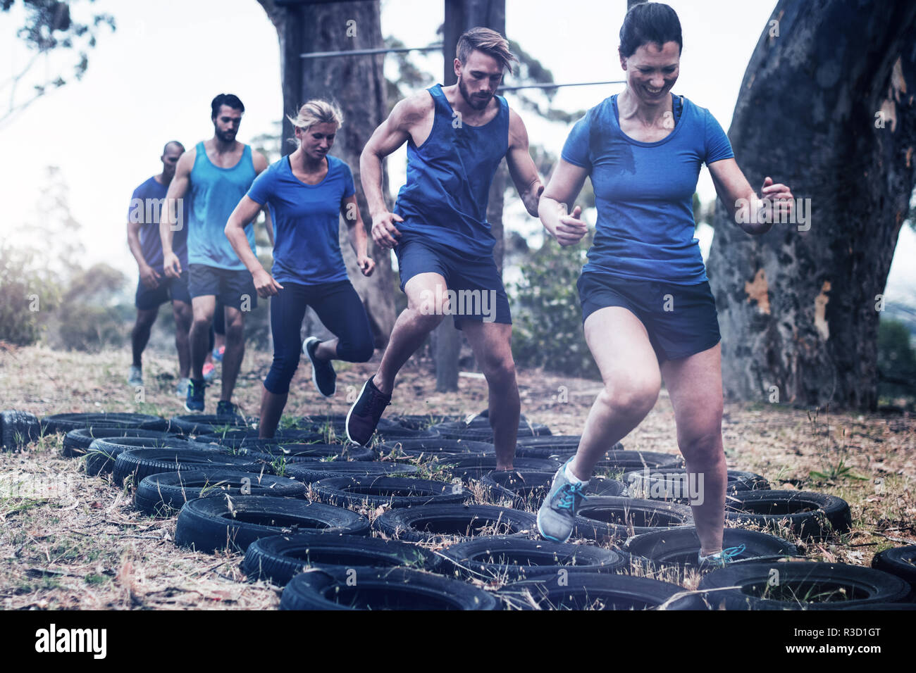 People receiving tire obstacle course training Stock Photo