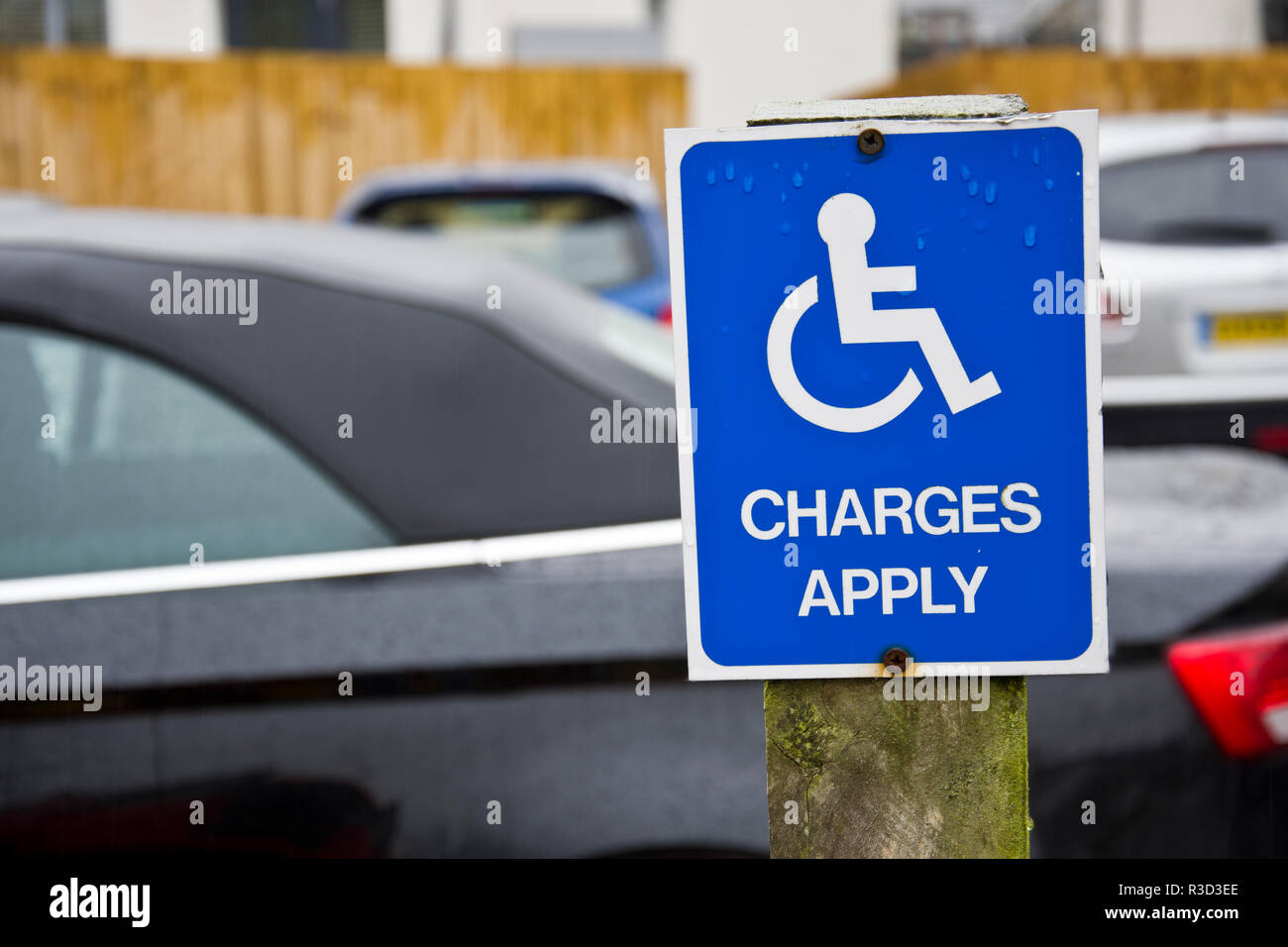 Sign reminding disabled drivers to pay for car parking. - Stock Image
