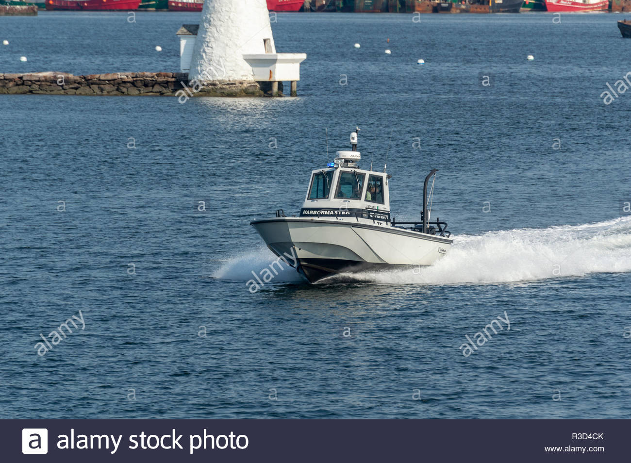 New Bedford, Massachusetts, USA - May 25, 2018: Port of New Bedford Harbormaster patrol boat heading for Buzzards Bay - Stock Image