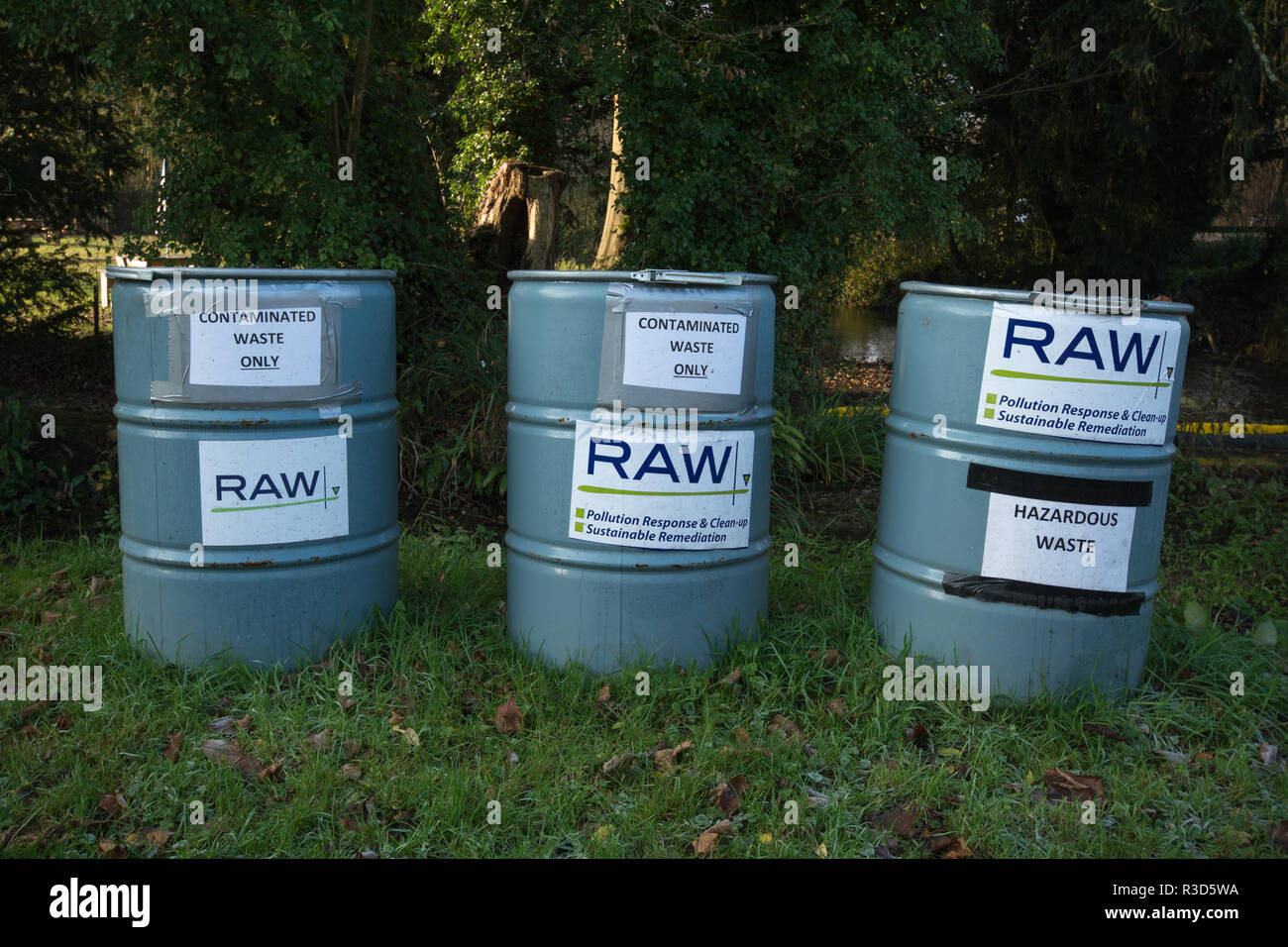 Contaminated waste containers, RAW, specialists in inland pollution spill or spills response and remediation, next to the river Meon in Hampshire, UK - Stock Image