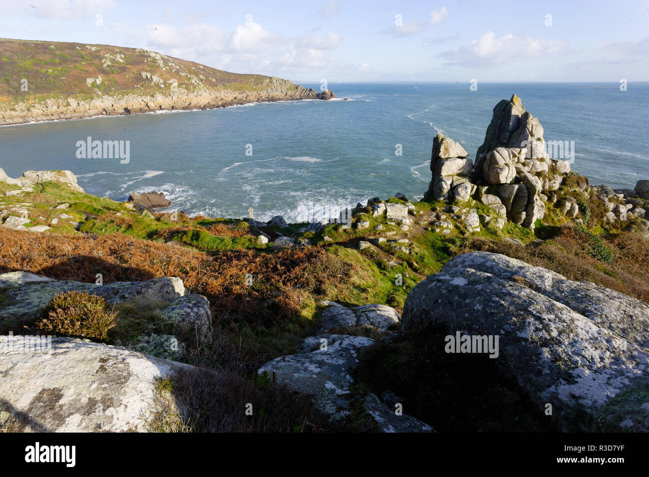 Porthcurno beach view empty with blue sky, Cornwall, UK. - Stock Image