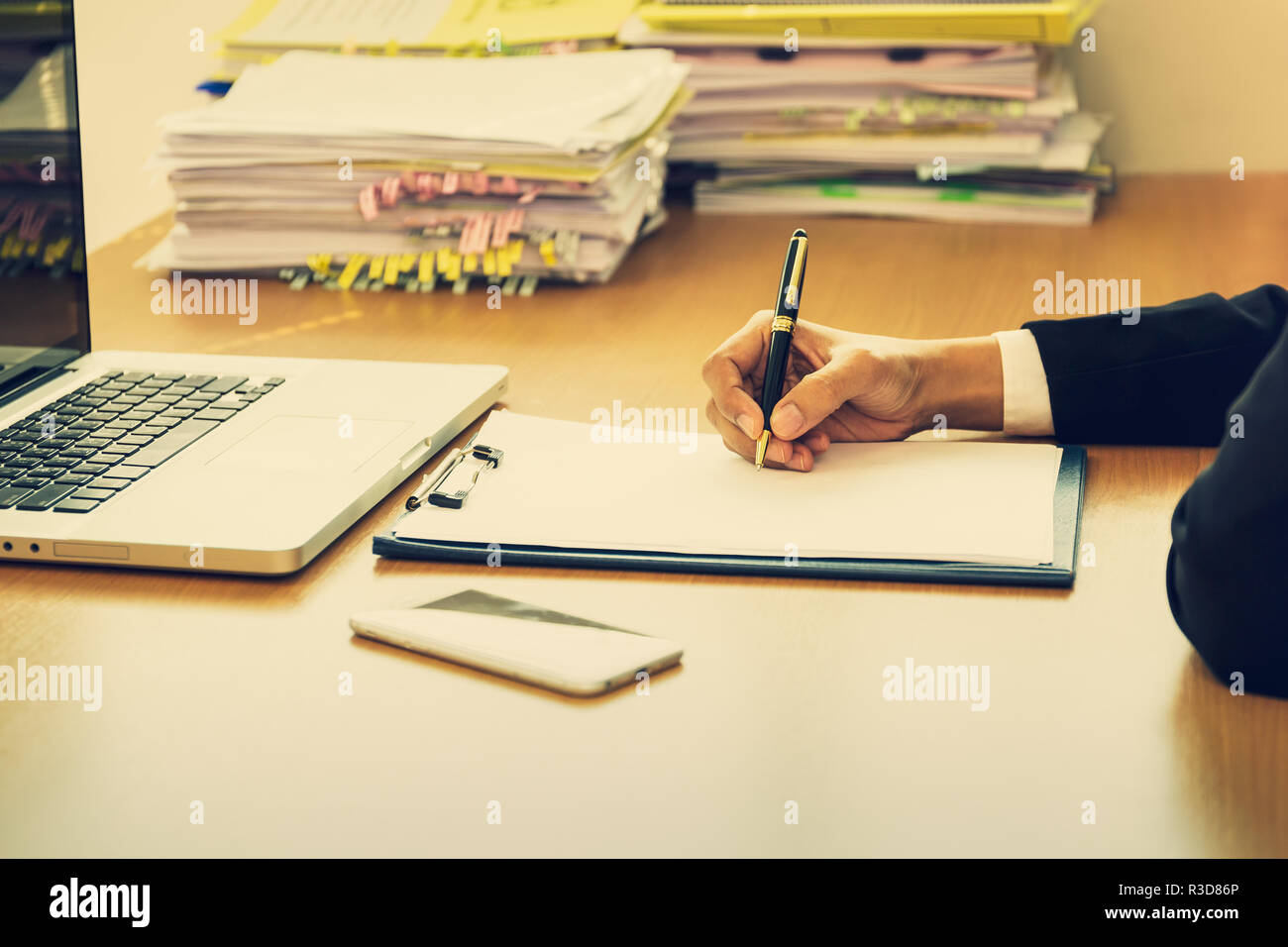 Business sucessful hand signing contract form on wooden desk in office. - Stock Image