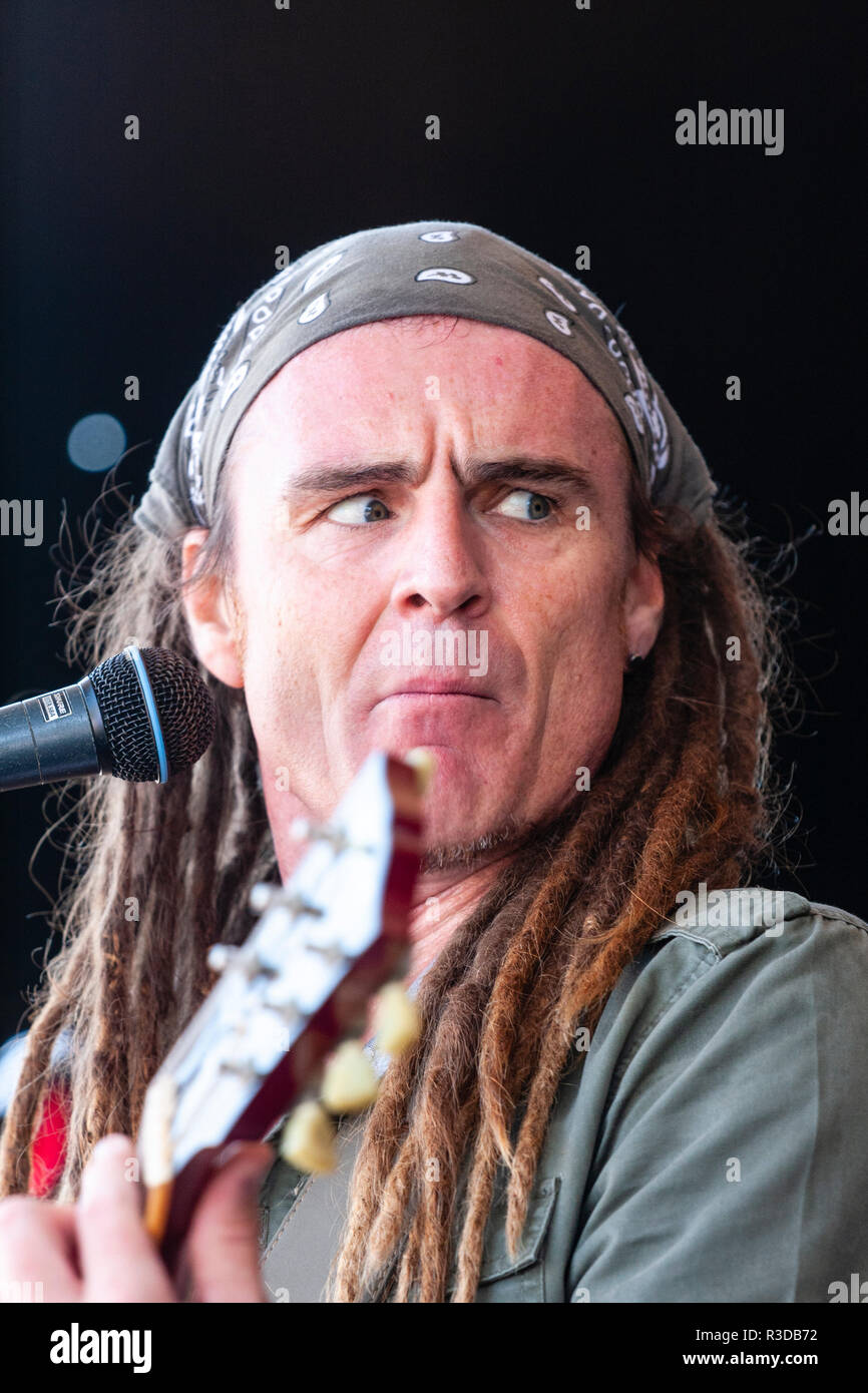 Faversham Hop Festival 2018, Lead singer from Ben Russell and The Charmers on stage. Caucasian man with dreadlock hair style playing guitar. - Stock Image