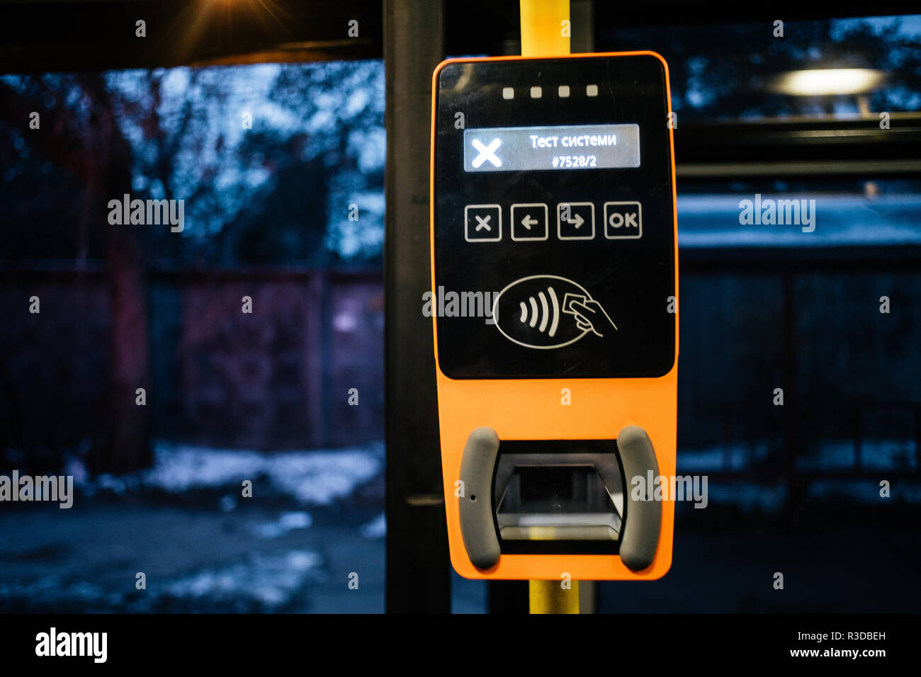 Modern bus punch validator close up in Kyiv, Ukraine - Stock Image
