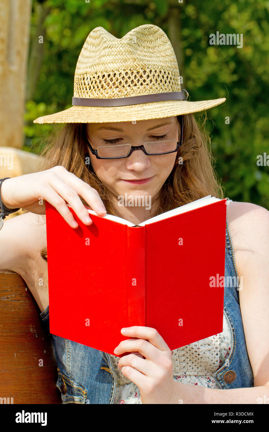 young woman with book Stock Photo