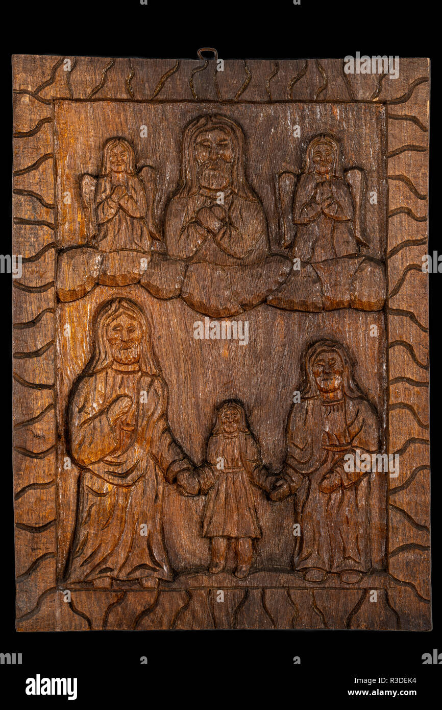 Naive or folk wood carving bas relief plaque representing Presentation of the Blessed Virgin Mary or The Entry of the Most Holy Theotokos into the Tem - Stock Image