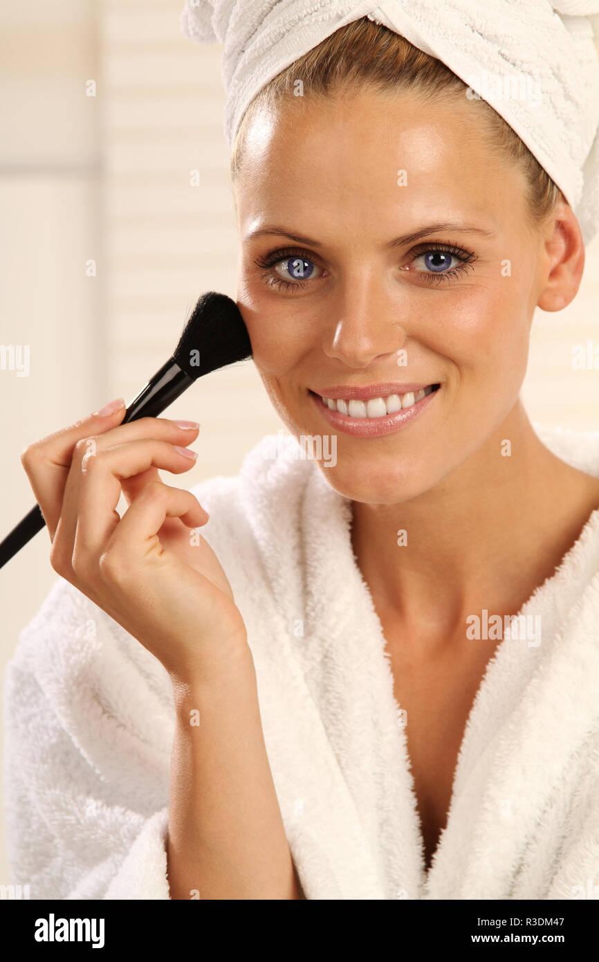 girl powdering her neck