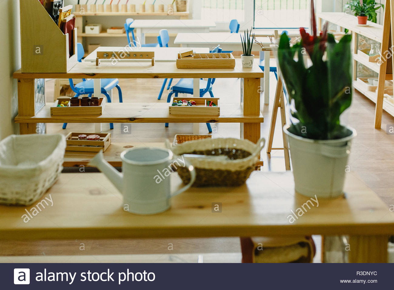 Learning materials in a montessori methodology school being manipulated by children - Stock Image