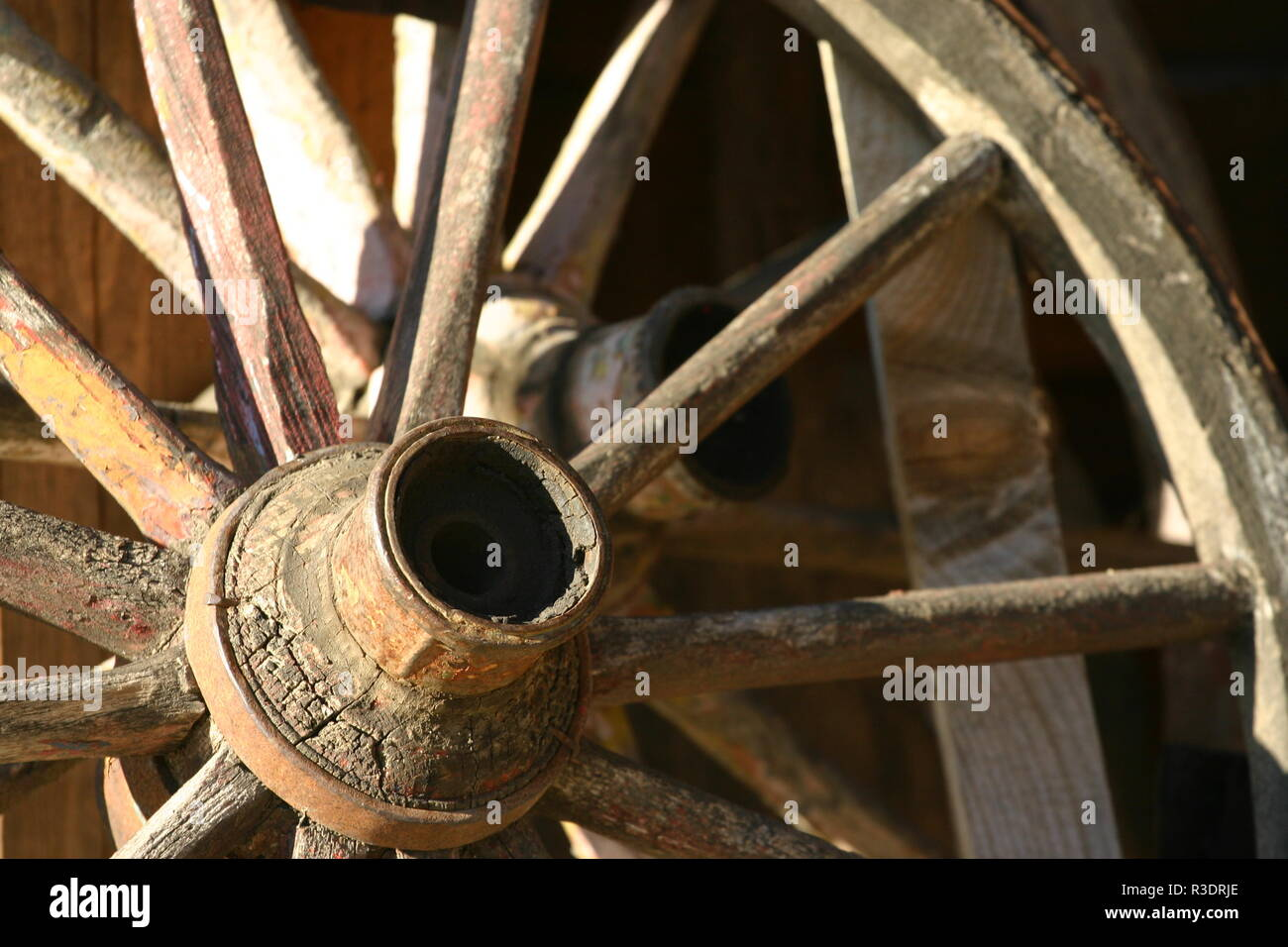 A shot at an old wooden cartweel. - Stock Image