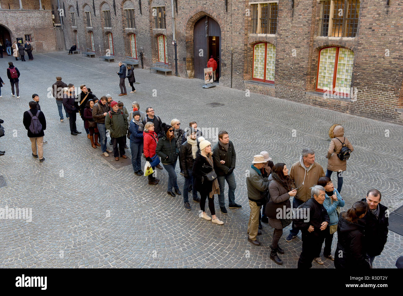 Toursts queueing to climb the Belfry Tower in Bruges (Brugge), Belgium Stock Photo