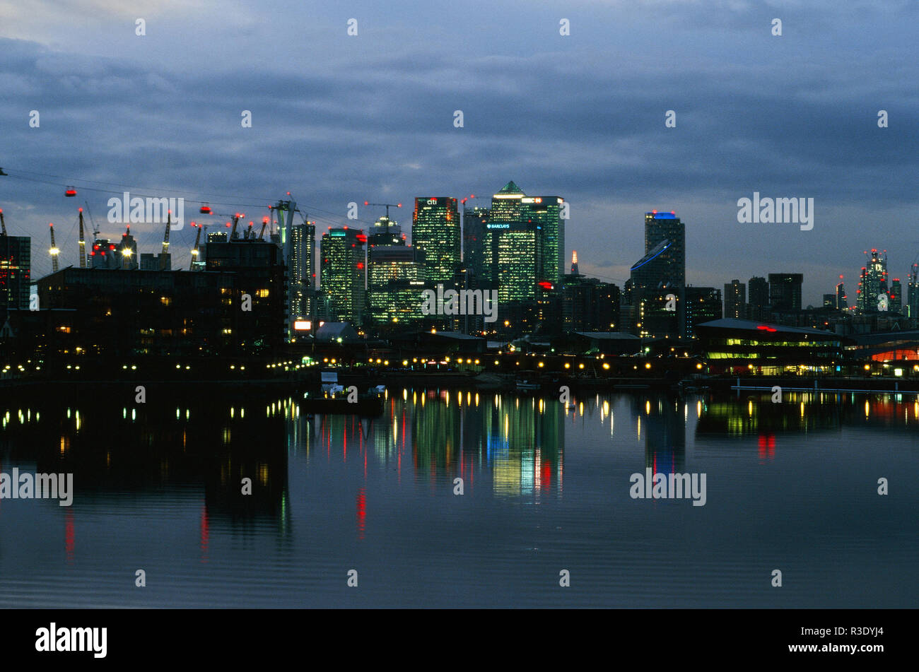 Canary Wharf on the Isle of Dogs at dusk, from Royal Victoria Dock, East London UK - Stock Image