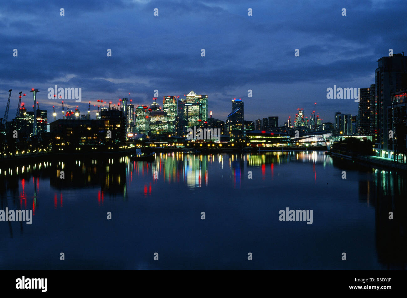 Canary Wharf and London Docklands at night, from Royal Victoria Dock - Stock Image