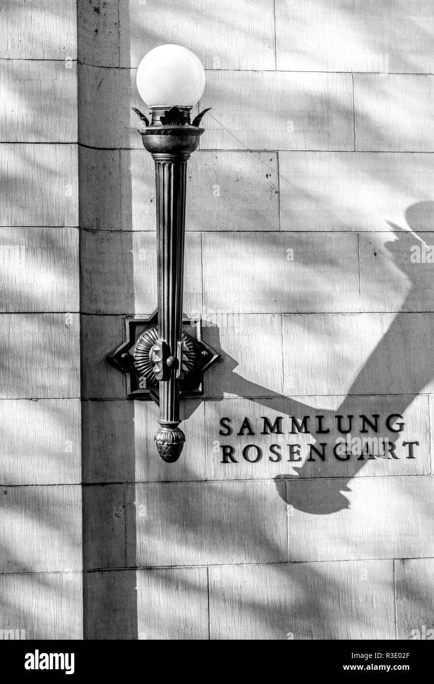 Elegant black metal lamp with round white glass globe on the exterior facade of the Rosengart Collection in Lucerne, Switzerland. Front entry level. - Stock Image
