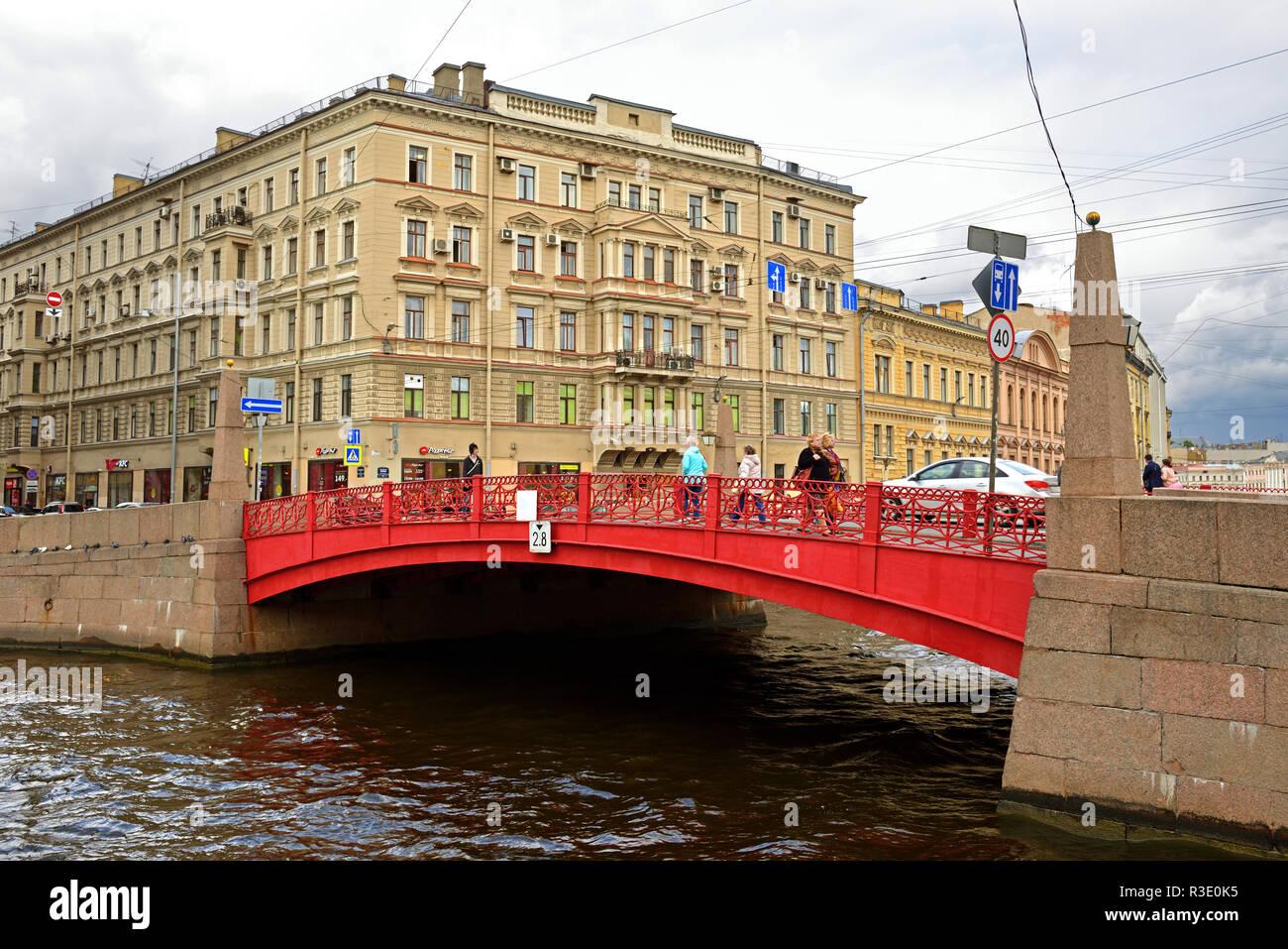 Red Bridge, single-span bridge across Moika River, and Profitable House - Stock Image