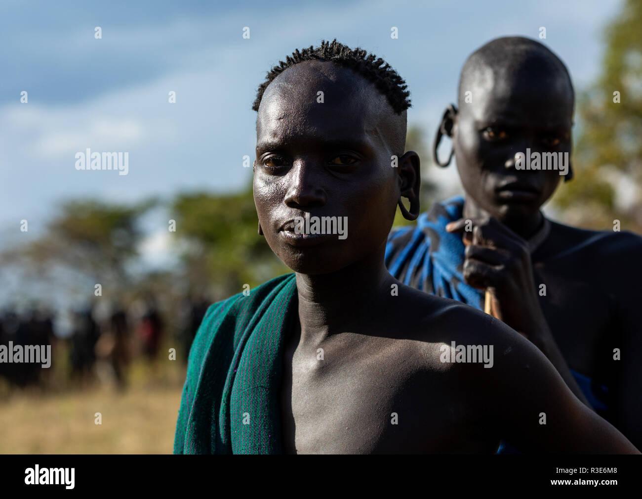 Suri tribe warriors during a donga stick fighting ritual, Omo valley, Kibish, Ethiopia - Stock Image