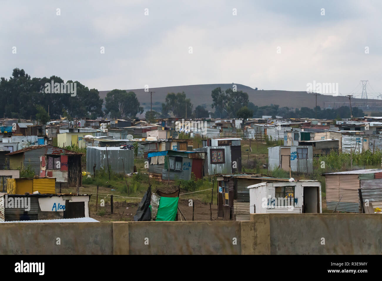 tin shacks or dwellings in a township in  Johannesburg, Gauteng,  South Africa showing poverty in the black African community - Stock Image