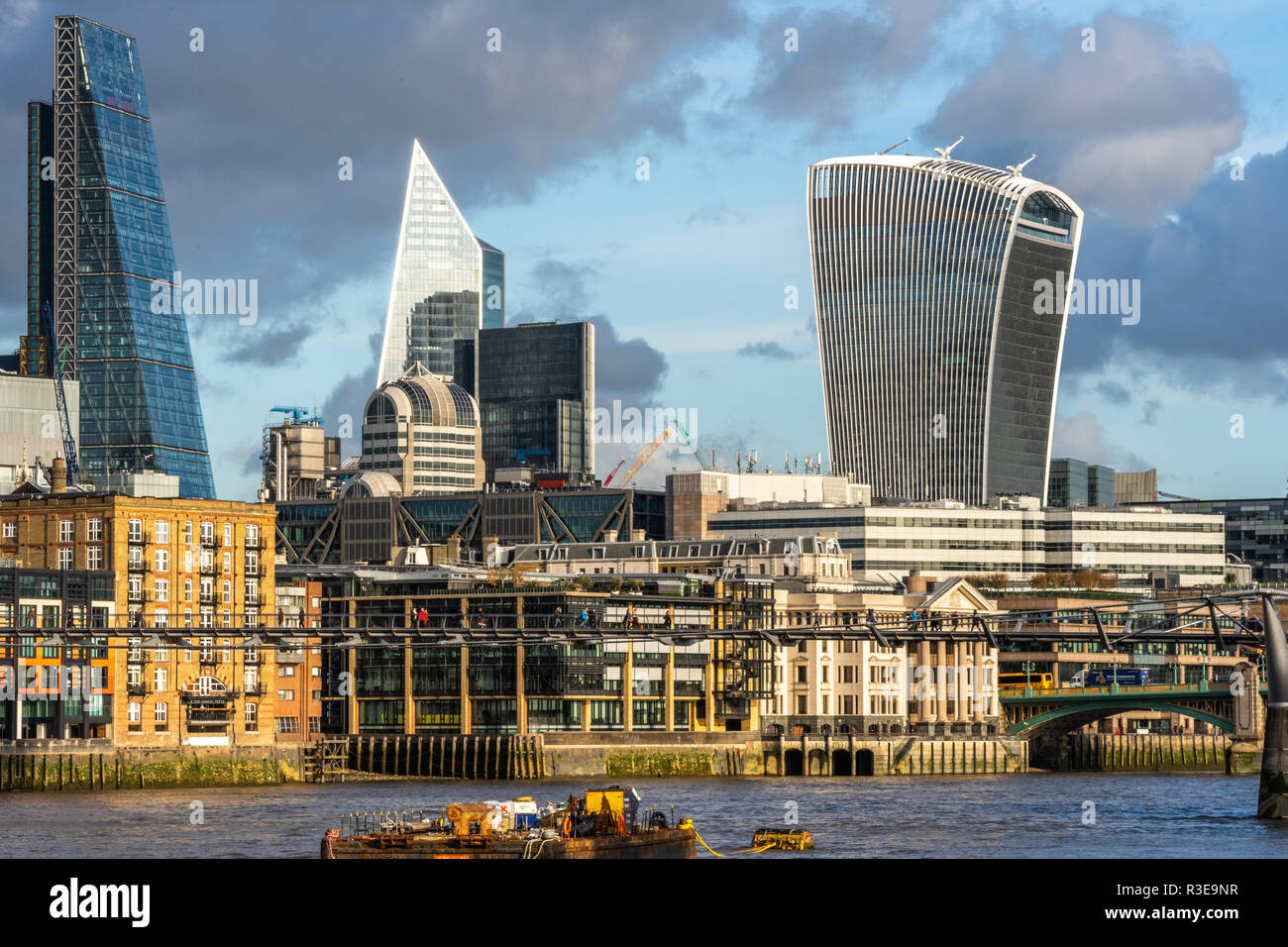 LONDON - NOVEMBER 15 : Modern skyscrapers in riverfront skyline of London, England against blue skies on sunny day on 15 November 2018 Stock Photo