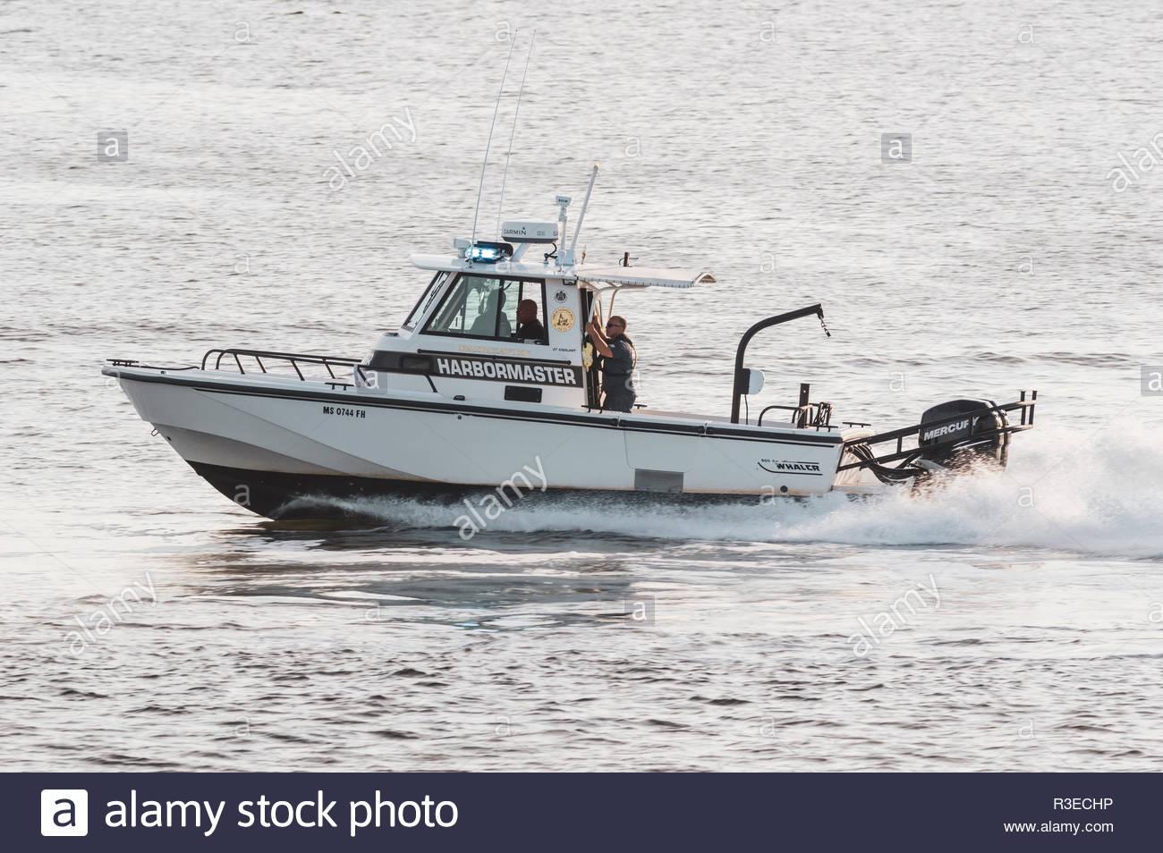 Fairhaven, Massachusetts, USA - August 31, 2018: Fairhaven harbormaster patrol boat heading toward Buzzards Bay - Stock Image