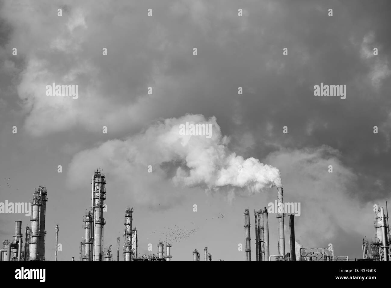 Plume of smoke rising from the tower of an industrial oil and gas refinery in Corpus Christi, Texas / USA. - Stock Image