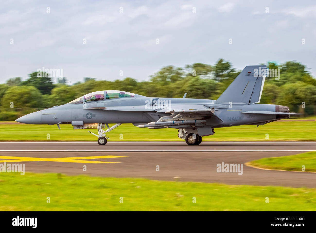 US Navy McDonnell Douglas F/A-18E Hornet is a twin-engine, supersonic, all-weather, carrier-capable, multirole combat jet, designed as both a fighter  - Stock Image