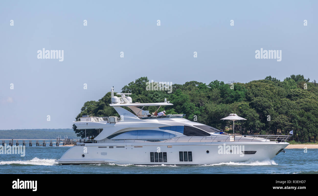 large yacht underway with North Haven and Sag Harbor in the background - Stock Image