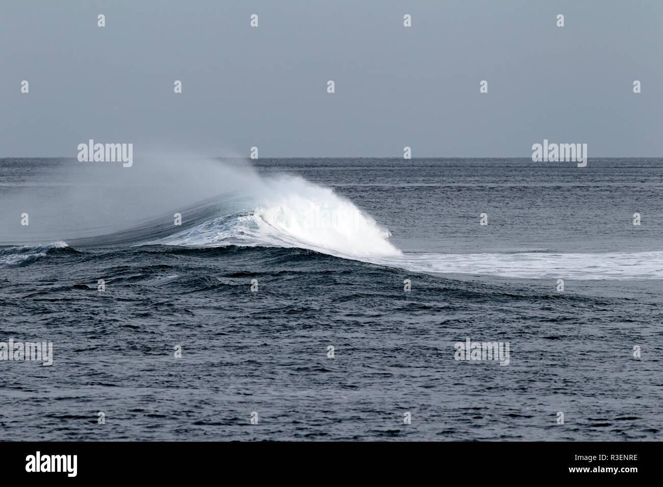 rogue wave building on the north antrim coast near Ballintoy county antrim northern ireland - Stock Image
