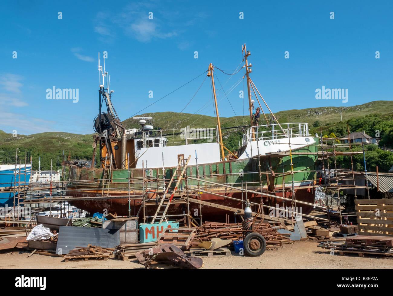 Fishing boat the Arnborg under repair in Mallaig boat yard, Mallaig, Scotland. Stock Photo