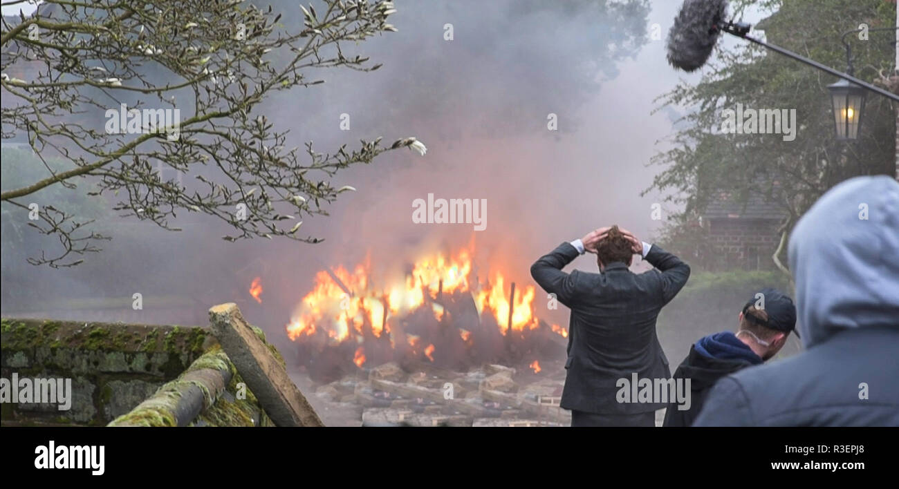 Great Budworth, UK. 11th April, 2018. Actor Rafe Spall dressed in Edwardian costume, head in hands among the carnage in the new BBC drama 'War Of The  - Stock Image