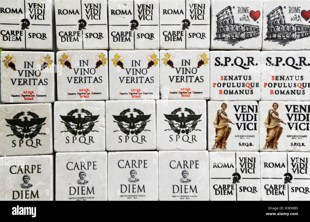 Famous Latin phrases used for souvenirs in Rome (I came, I saw, I conquered - seize the day). Rome, Italy - Stock Image