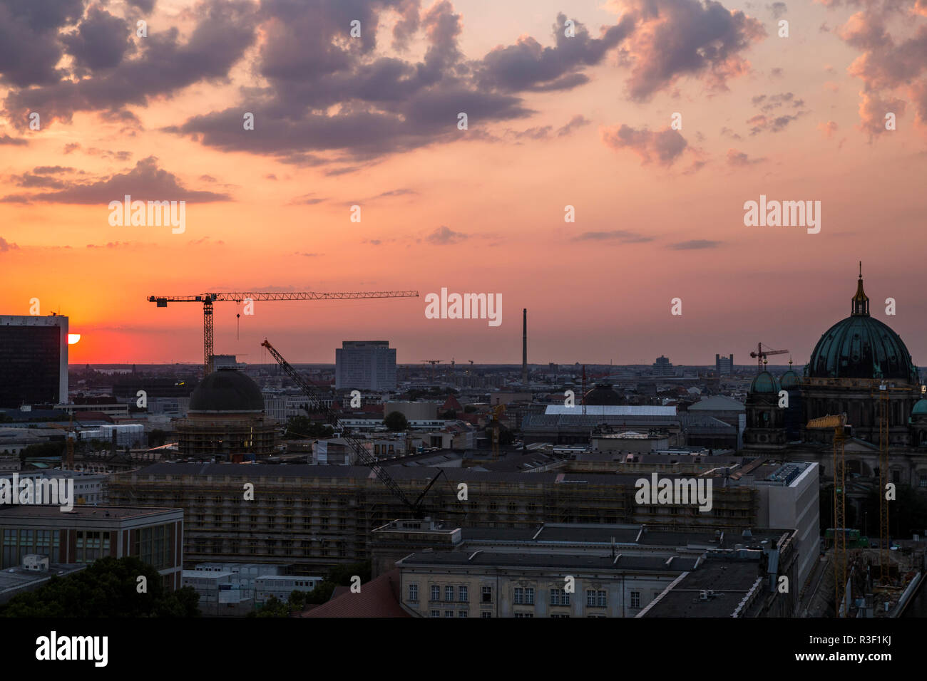 The sun sets over the north of Berlin, seen from the Fischerinsel in