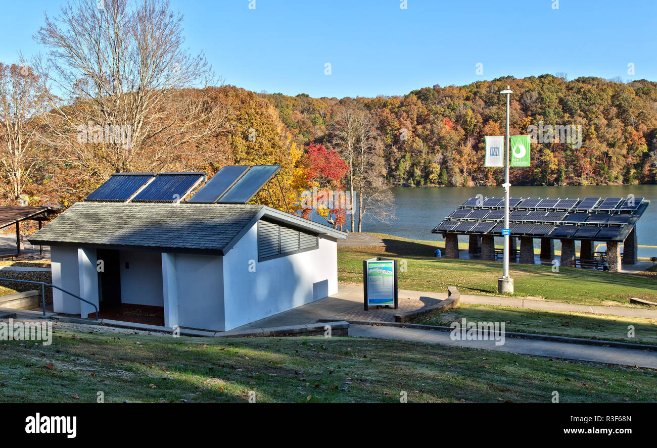 Solar hot water heaters on bathroom roof,  with solar panels in background, facilitating Melton Hill Dam Sustainable Recreation Area Campground. - Stock Image
