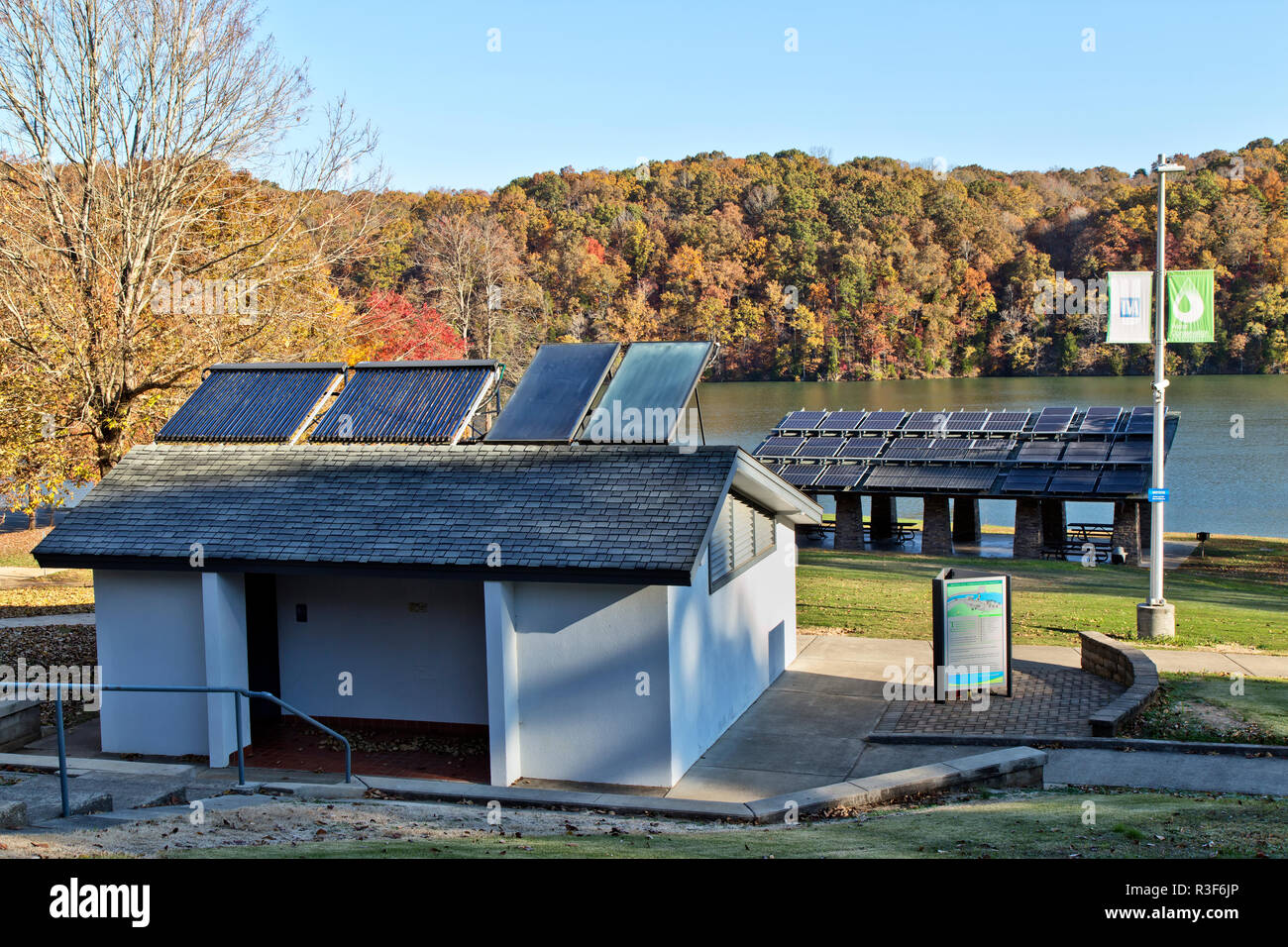 Solar hot water heaters on bathroom roof,  with solar panels in background, facilitating Melton Hill Dam Recreation Area Campground. - Stock Image