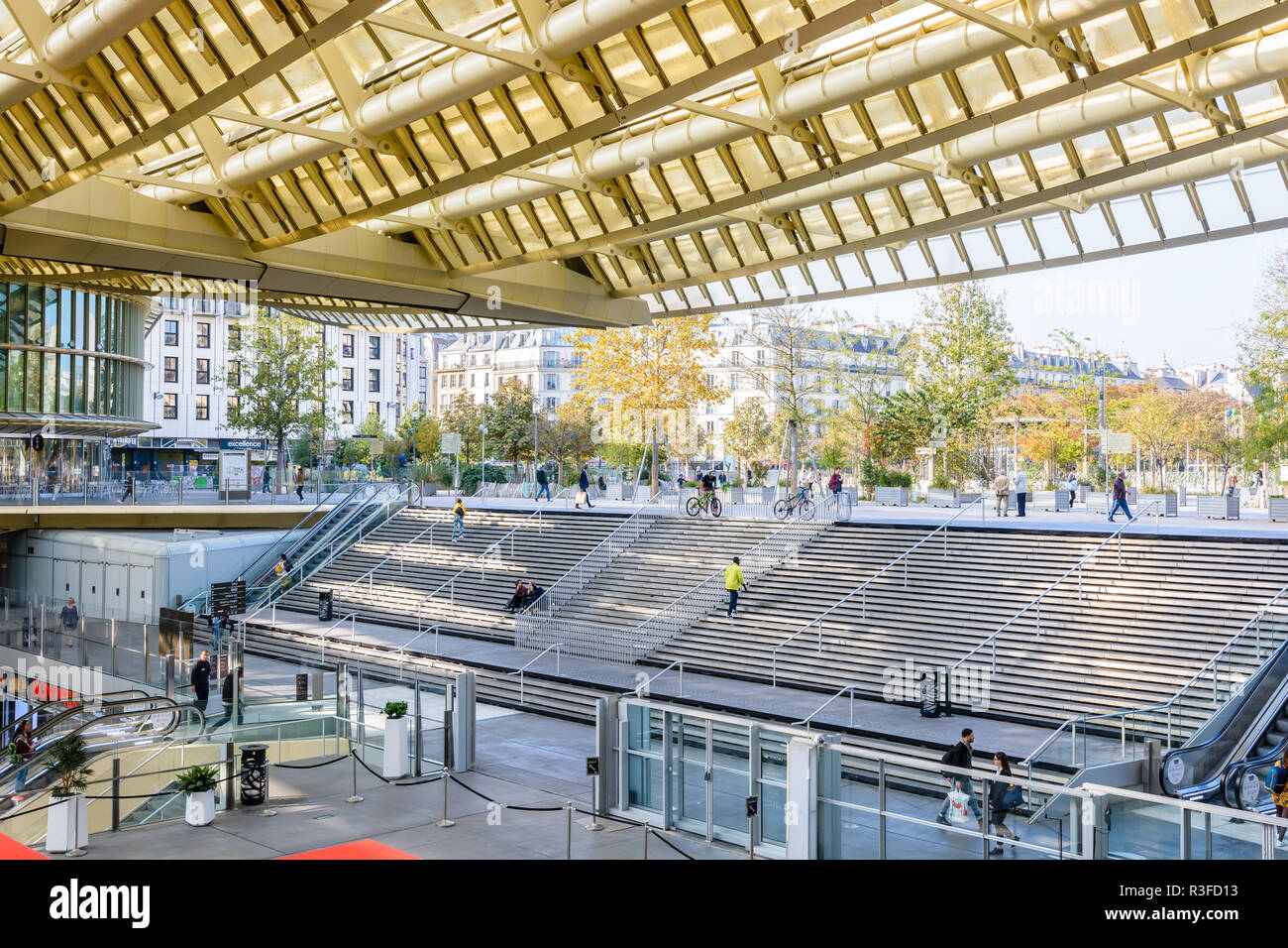 The large stairways leading down to the Forum des Halles underground shopping mall in the center of Paris, covered by a vast glass and steel canopy. - Stock Image