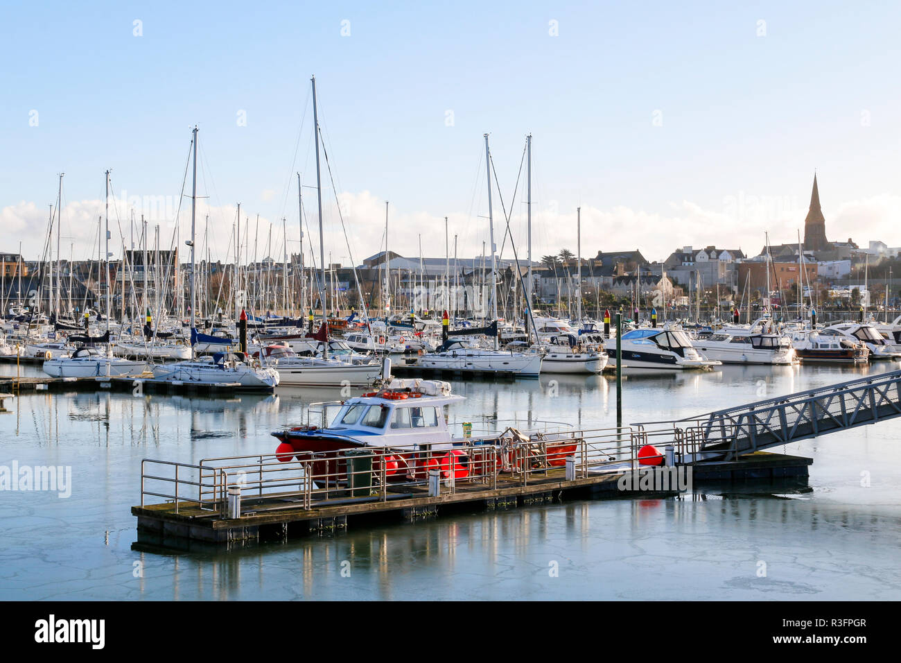 View across the marina in Bangor, County Down, Northern Ireland with the town in the background - Stock Image