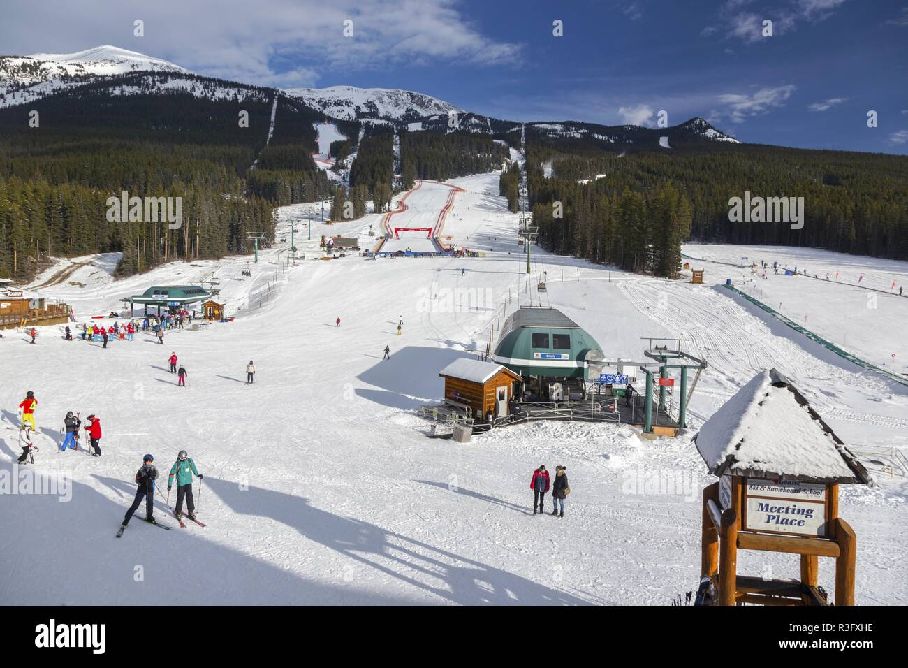 Skiers People at Snow Slopes of Lake Louise Resort, a site of FIS Men and Women Downhill Ski Event in Alberta Canada - Stock Image