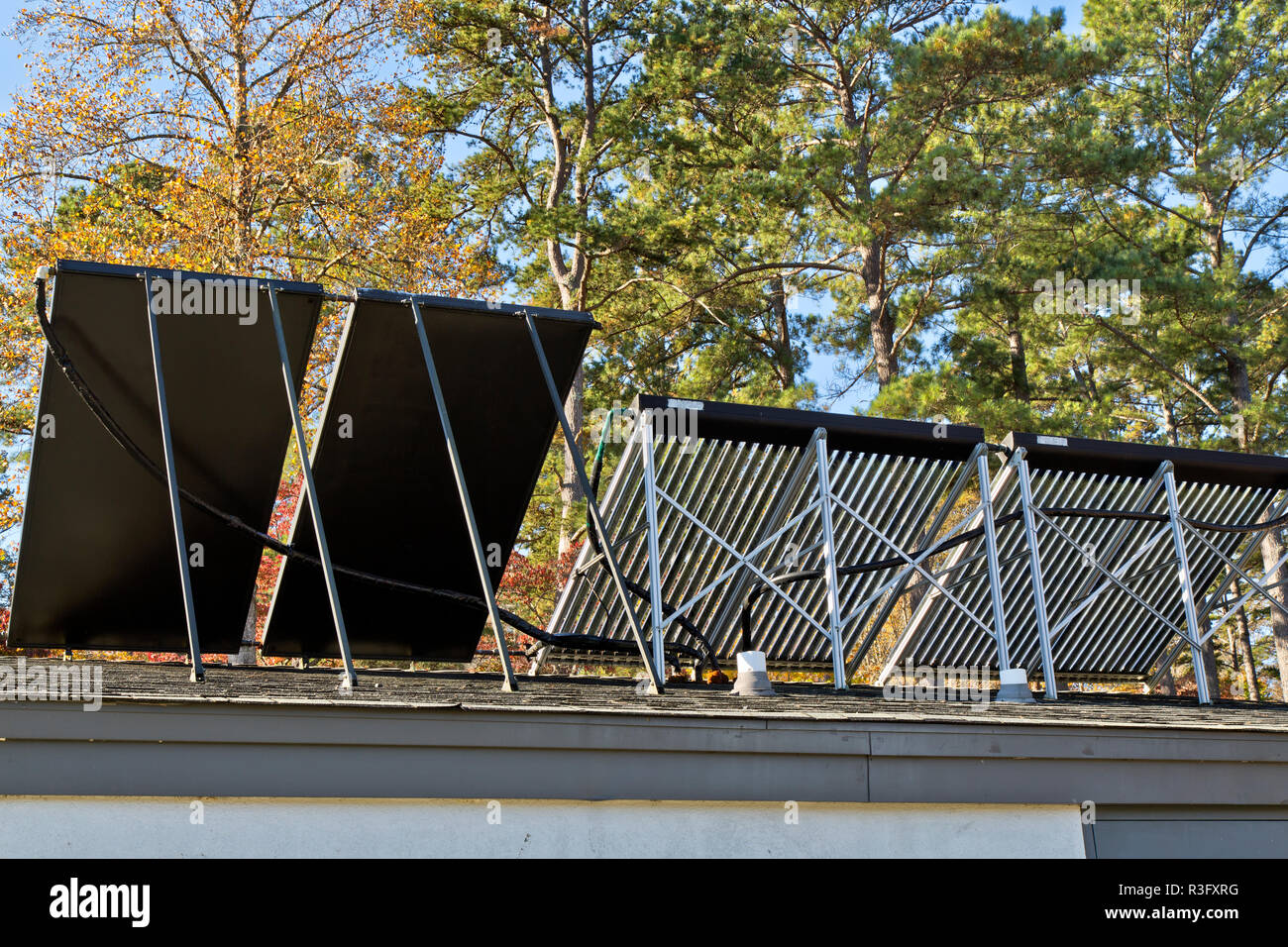 Rear view, solar hot water heaters on bathroom roof,  facilitating Melton Hill Dam Recreation Area Campground. - Stock Image