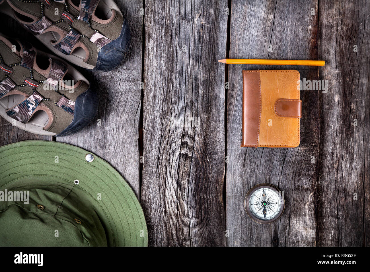 Traveler outfit on the wooden background - Stock Image