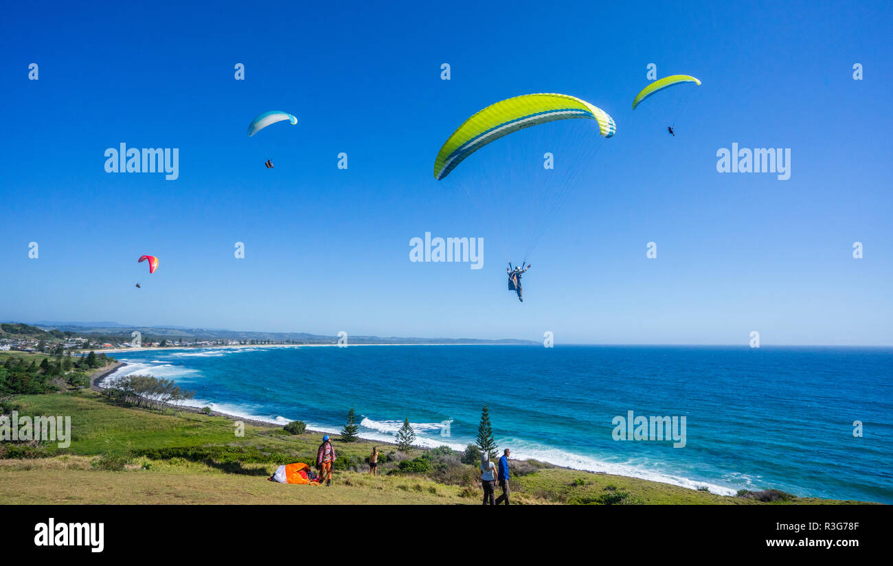 paragliding from Pat Morton Lookout at Lennox Head, north of Ballina, Norther Rivers region, New South Wales, Australia - Stock Image