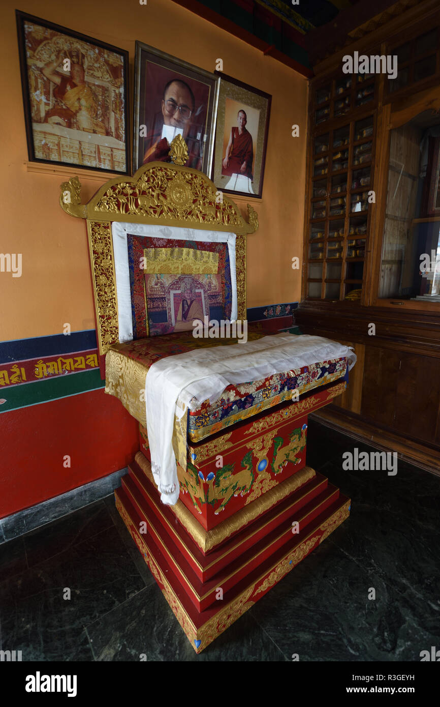 The seat of the 14th Dalai Lama kept inside the middle temple and prayer hall of the Kagyu Thekchen Ling at Lava in Darjeeling district of West Bengal - Stock Image