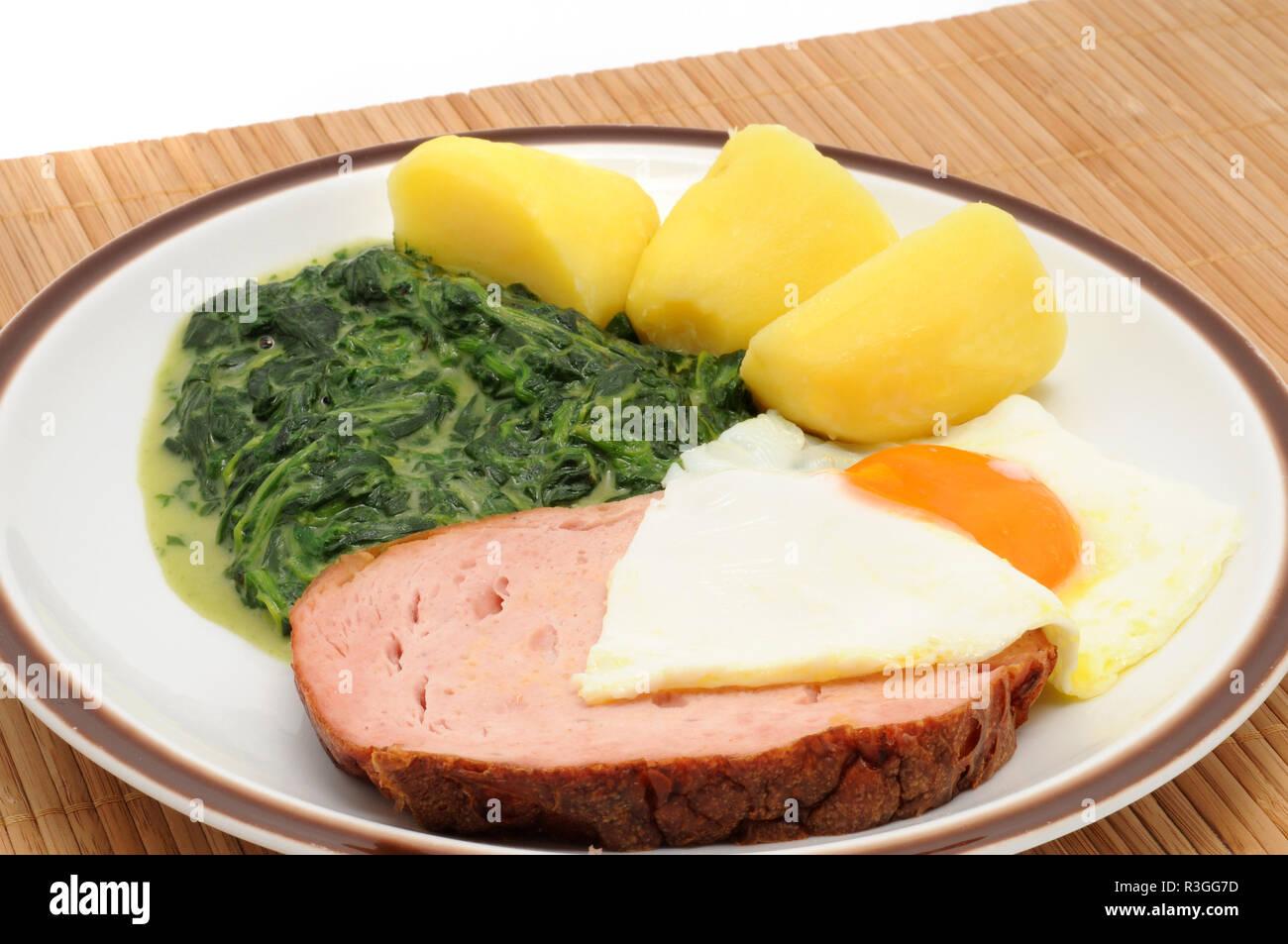 leberkaese with spinach / leberkaese with spinach Stock Photo