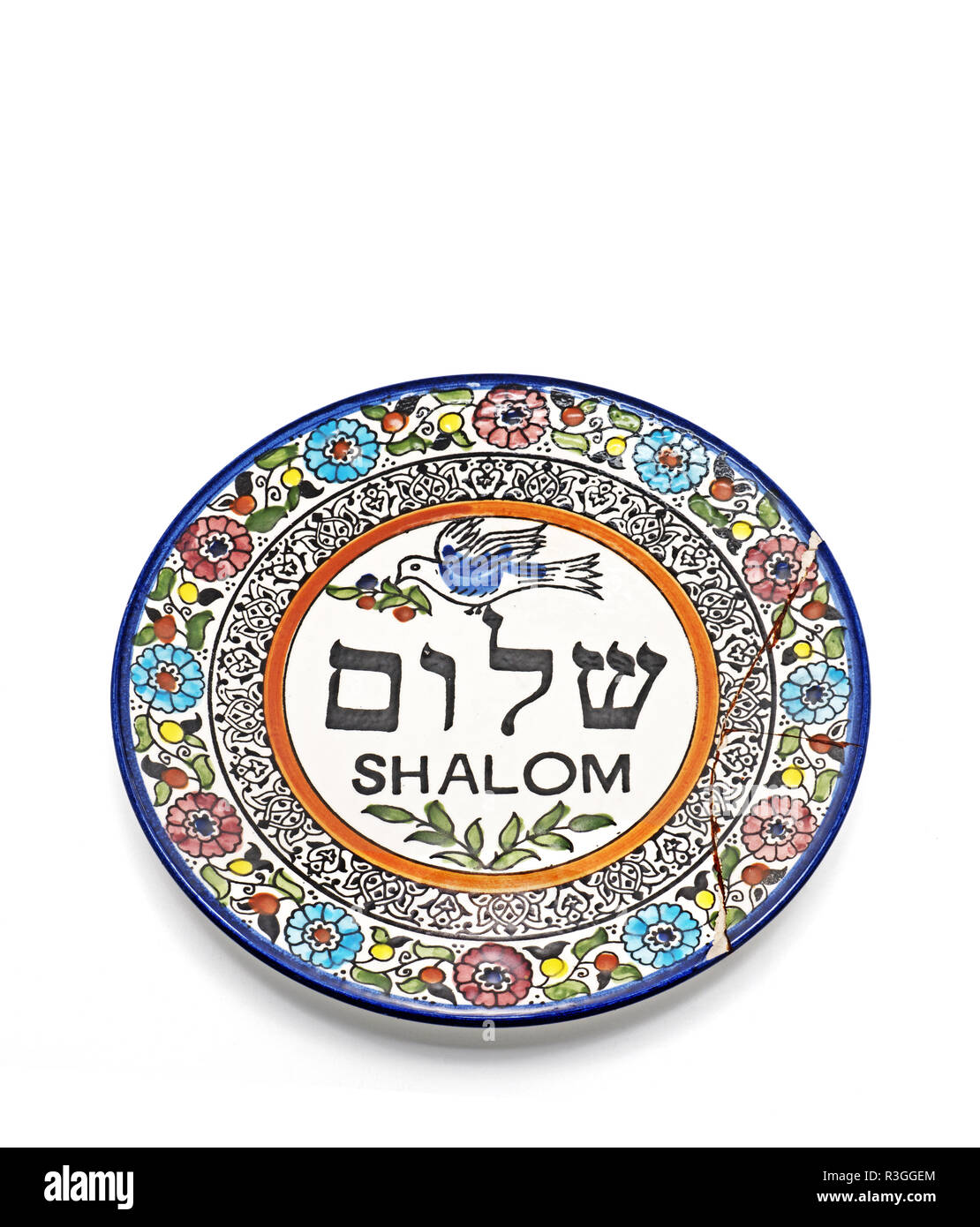 Antique Broken Ceramic Plate with Graphics and Hebrew Language Translation to word Shalom meaning to peace Isolated on White Background, Picture Conce - Stock Image