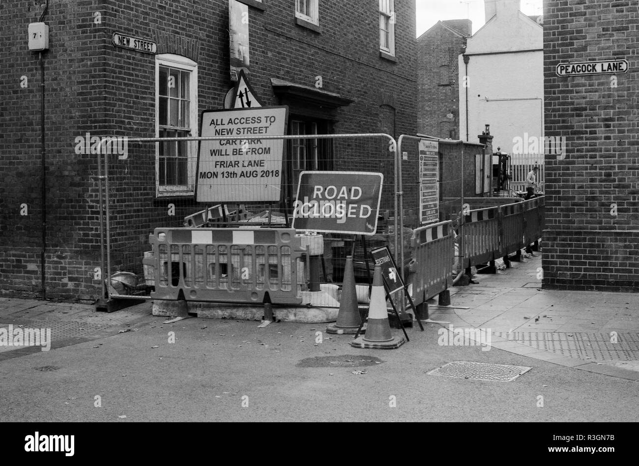 Road works on the junction of New Street & Peacock Lane in Leicester City shot on Ilford 35mm film & Pentax K1000 slr camera - Stock Image